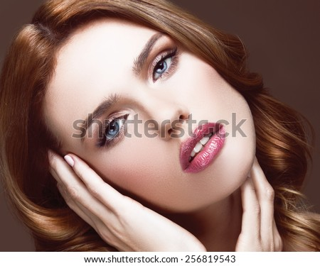 Beautiful Woman with Healthy Long curly red Hair. Hairstyle. Beauty Glamour Fashion Model Girl Portrait. Perfect Skin and Makeup Natural Make up. Blue eyes and light pink lipstic - stock photo