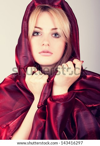 Beautiful woman with red scarf - stock photo