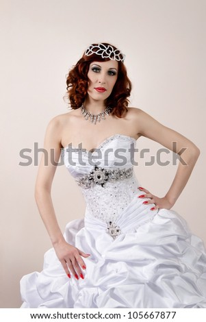 beautiful young bride in white dress - stock photo