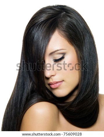 beautiful young brunette woman with long straight  hair posing isolated on white background. Beauty face with closed eyes - stock photo