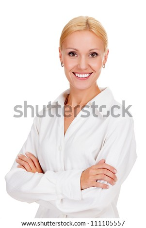 Beautiful young businesswoman standing with hands folded against white background - stock photo