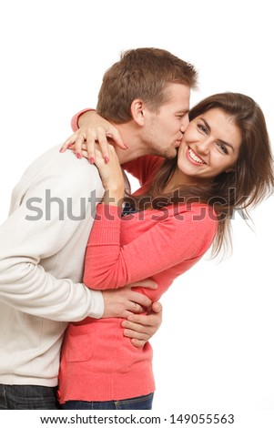beautiful young couple embracing and laughing - stock photo