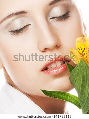 Beautiful young woman with yellow flowers - stock photo