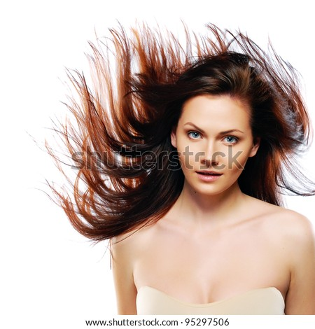 beauty model in studio with hair blown by wind - stock photo