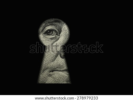 Benjamin Franklin's eye in the keyhole - stock photo