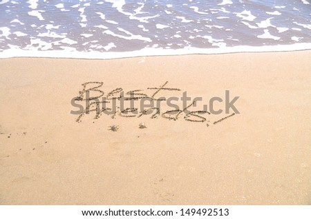 """best friends,"" a message written in the sand - stock photo"