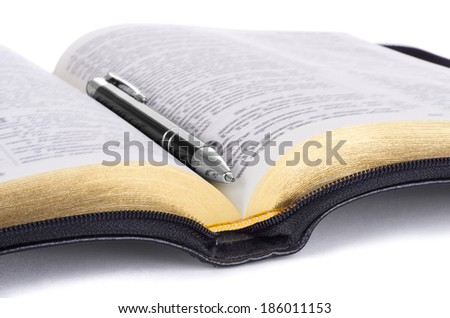 Bible with pen, isolated - stock photo