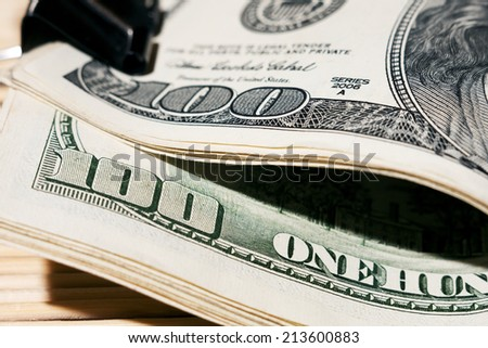 $ 100 bills on the table. filming close-up - stock photo