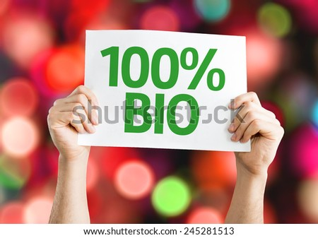 100% Bio card with colorful background with defocused lights - stock photo