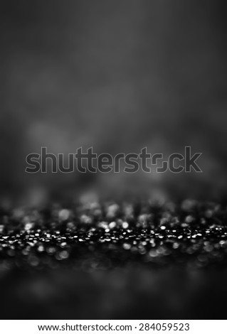 Black Defocused Bokeh twinkling lights Vintage background. Festive Christmas elegant abstract background with bokeh lights and stars.  - stock photo