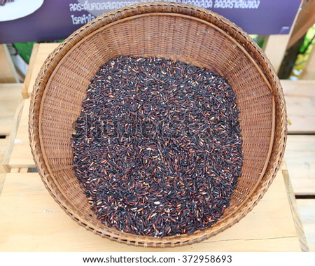 black rice in bamboo weave basket - stock photo