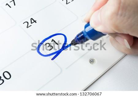 ?Blue circle. Mark on the calendar at 31. - stock photo