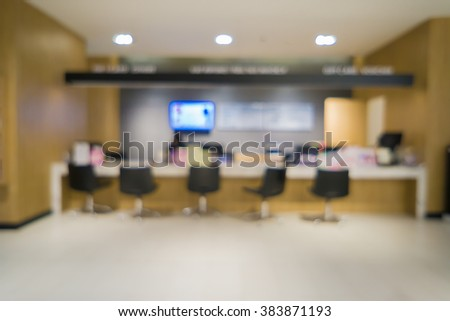blur background of payment services interior.Payment with smartphone at checkout in nursery retail store,counter service at hotel for background usage.can use for background product .vintage tone - stock photo