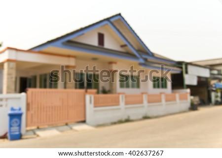 Blur image of large house of village background - stock photo