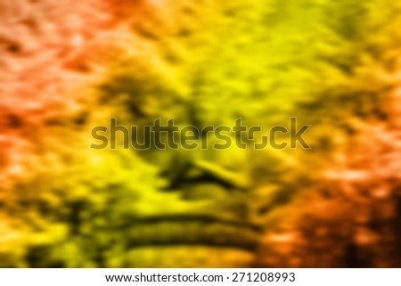 (BLUR style Abstract background) Autumn leaves behind a Buddha statue. Tokyo. - stock photo