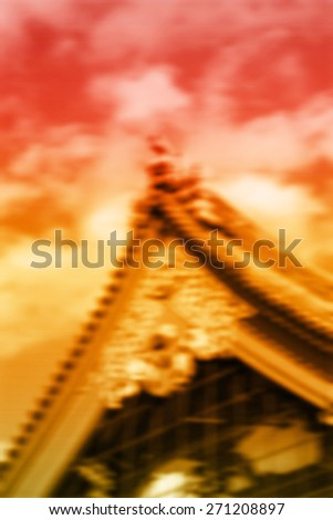 (BLUR style Abstract background) Ornate roof work with gold Buddhist symbol. Tokyo. - stock photo