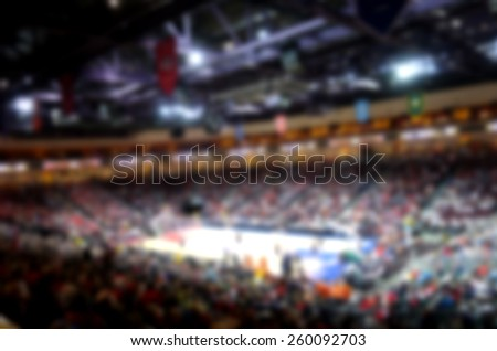 blurred background of basketball crowd in arena                              - stock photo