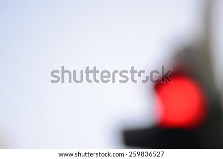 blurred background, red traffic light - stock photo