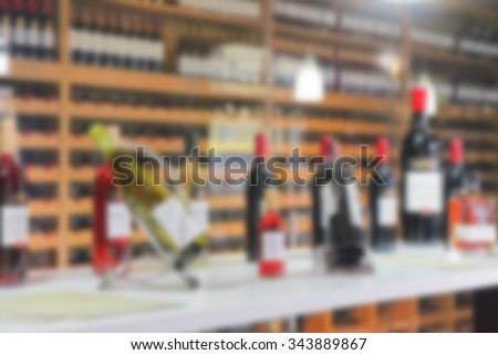 blurred background -the wine bottles at the wine shop - stock photo