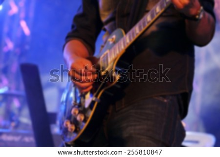 blurred musician on concert - stock photo