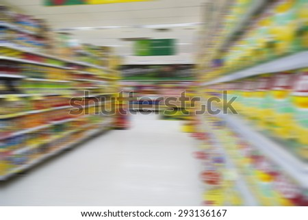 Blurred supermarket background and unidentified people who are shopping - stock photo