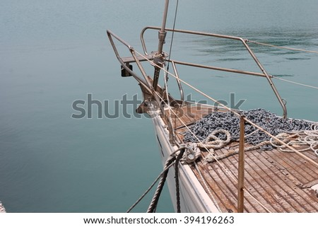 boat and oars on the water - stock photo