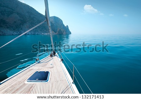 boat floats near the shore. Luxury Lifestyle - stock photo
