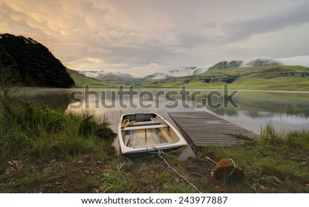 Boat, jetty, Mountain lake. Giant's Cup Wilderness reserve, Kwazulu Natal, South Africa - stock photo