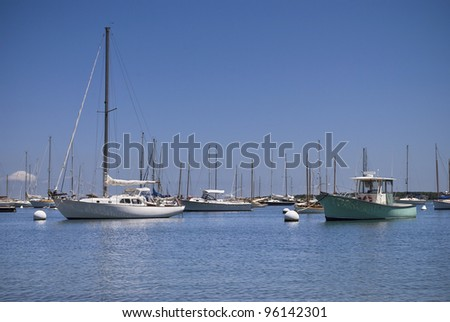 """Boats in Marina"" Sailboats on a sunny Summer day off Martha's Vineyard on Cape Cod in Massachusetts. - stock photo"