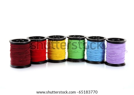 bobbins of thread isolated on white - stock photo