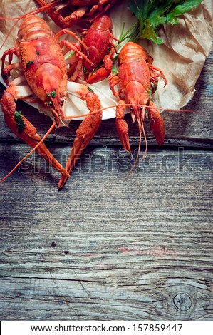 Boiled crayfish on a wooden background - stock photo