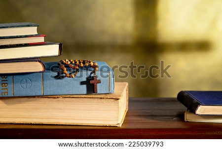books and rosary in the church - stock photo