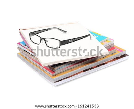 books stack with glasses  isolated on white background - stock photo