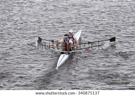 BOSTON - OCTOBER 18, 2015: Dolphin races in the Head of Charles Regatta Men's Master Doubles [PUBLIC RACE] - stock photo