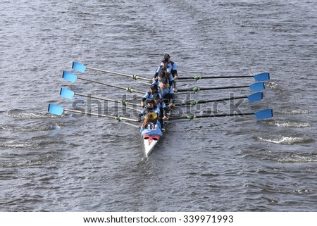 BOSTON - OCTOBER 18, 2015: Philadelphia City Rowing races in the Head of Charles Regatta Women's Youth Eights [PUBLIC RACE] - stock photo