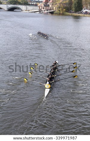 BOSTON - OCTOBER 18, 2015: Port Rowing (top) Nauset Tech (bottom) races in the Head of Charles Regatta Women's Youth Eights [PUBLIC RACE] - stock photo