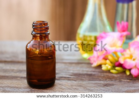 bottle of essential oil  - stock photo