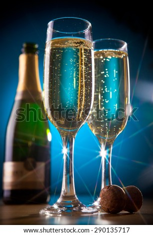 Bottle of sparkling wine and champagne glasses - stock photo