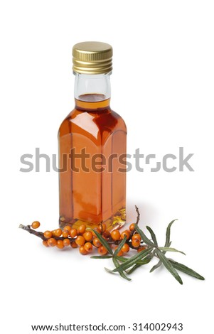 Bottle Sea buckthorn oil  with a twig of common sea-buckthorn on white background - stock photo
