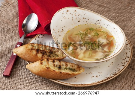 Bowl of traditional chicken soup served in  bowl - stock photo