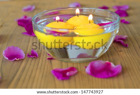 Bowl with candles and flower petals, selective focus - stock photo