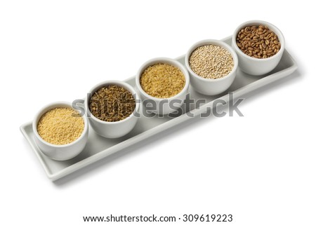 Bowls with raw world food seeds - stock photo