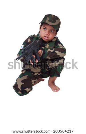 boy dressed like a soldier with rifle isolated on white background with clipping path - stock photo