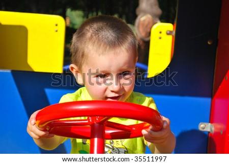 boy play on playground - stock photo