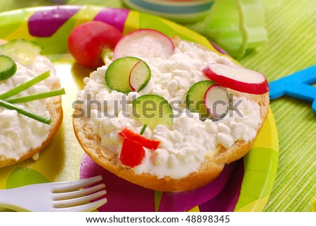 breakfast for child with puppy shape sandwich - stock photo