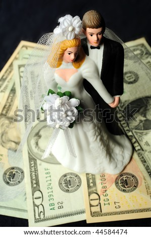 bridal couple with money - stock photo