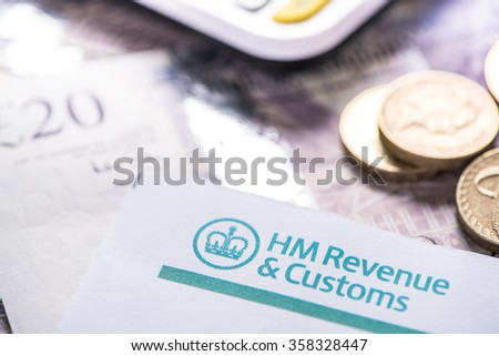 2016 British Tax return reminder with notes and coins - stock photo