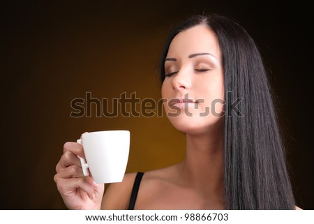 brunette with a cup of coffee - stock photo