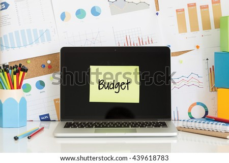 BUDGET sticky note pasted on the laptop screen - stock photo