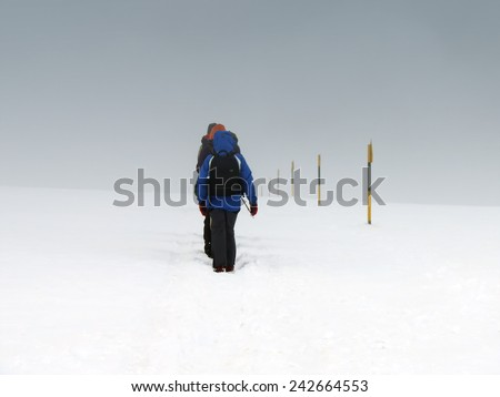 Bunch Of Climbers Under Extreme Weather Condition          - stock photo